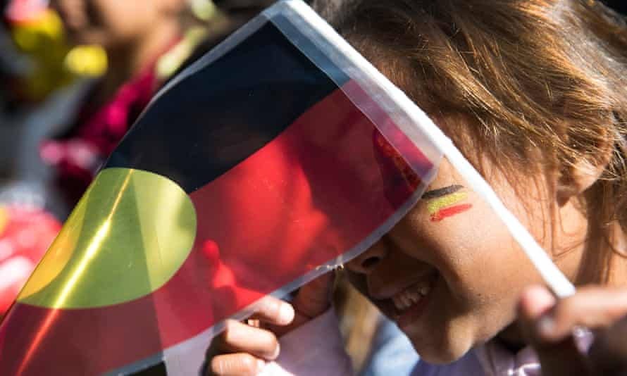 A girl at a march for a 'new agenda' for Aboriginal rights, including a makarrata process, in 2018.