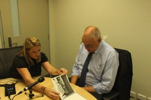 ABC journalist Rachel Brown and retired homicide detective Ron Iddles looking through photos of the crime scene for Trace, a new podcast investigating the 1980 murder of Melbourne mother Maria James. Photo: supplied by the ABC.