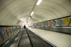 A man walks through a very quiet underground station during what would traditionally be a busy period for commuter travel, on 26 March, 2021 in London, England. A year after the first Covid-19 lockdown discouraged use of public transit, ridership on the London Underground, which recorded around 4 million rides every weekday pre-pandemic, was hovering around 20 percent of normal. Transport for London worries it will take two years before ridership - and hopefully the agency's finances - returns to normal.