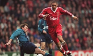 Stan Collymore takes on Arsenal's Andy Linighan in December 1995.