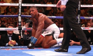 Anthony Joshua gets to his feet after being knocked down in the third round