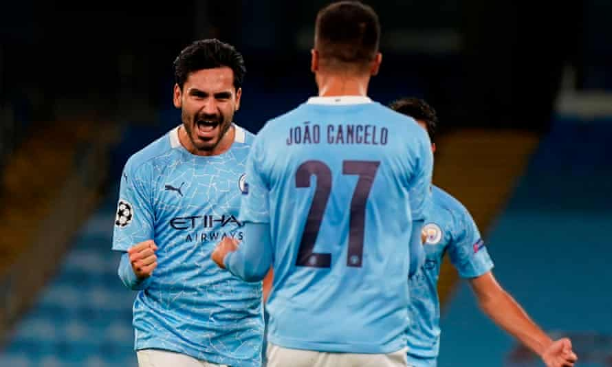 Ilkay Gündogan celebrates after his fine free-kick gave Manchester City the lead in the second half against Porto.