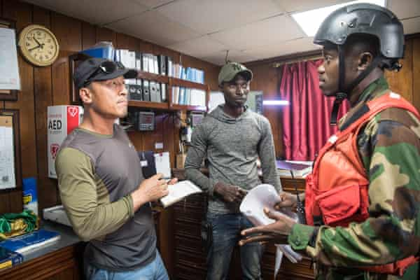 Petty officer George Kromah issues a warning to the captain of the Oriental Kim