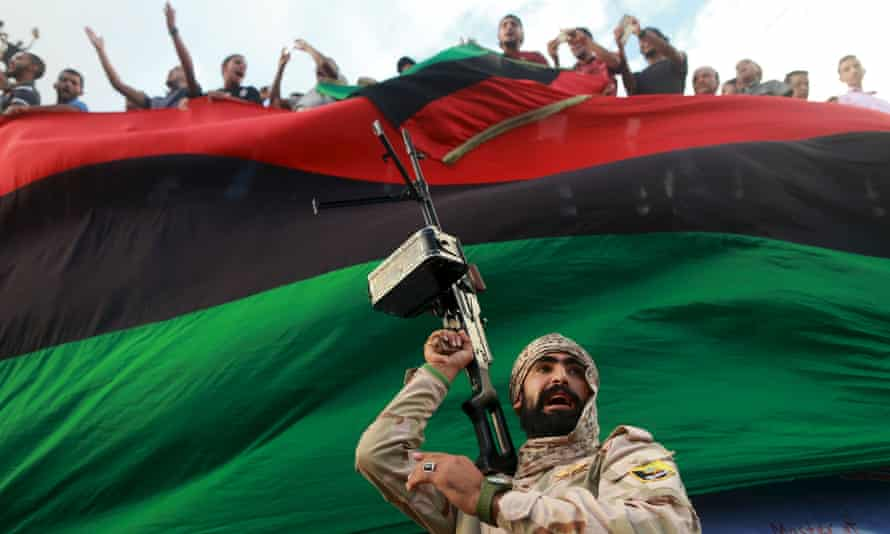 A Libyan soldier protects demonstrators
