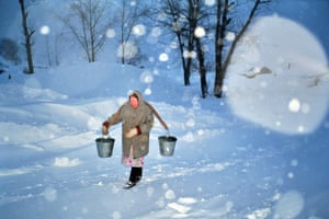 Woman Carrying Water Buckets in Snow 1998