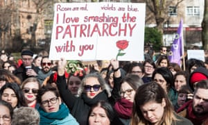 Women strike in London on International Women's Day. 'Women ask as often as men for a pay rise - yet men are four times more likely to get one.'