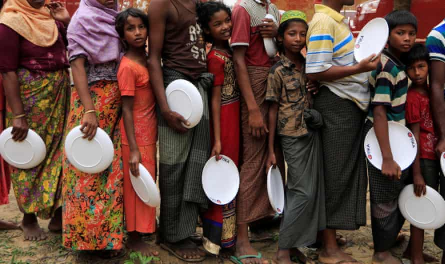 Rohingya refugees queue to get food distributed by the Turkish Cooperation and Coordination Agency near Cox's Bazar, Bangladesh