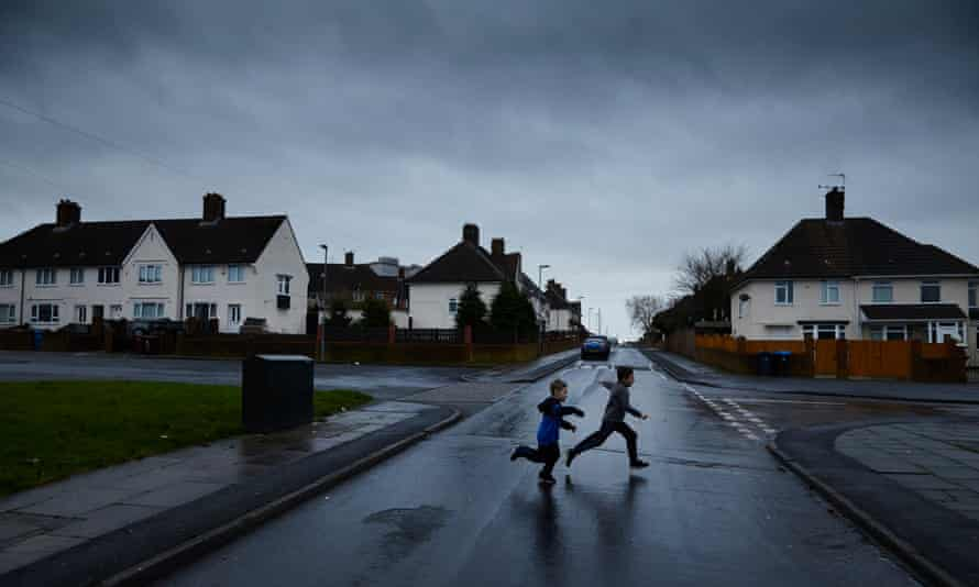 Boys playing in Pennard Avenue in Knowsley borough. Photograph: Christopher Thomond for the Guardian