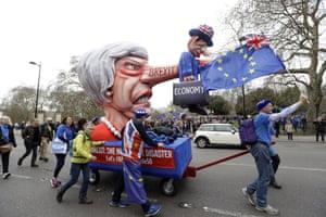 Amazing float featuring British economy impaled on Theresa May's nose