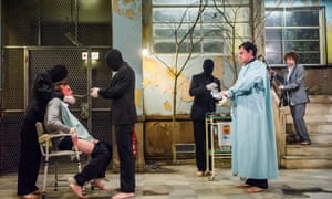 'Toolkit of despair': the torturers in balaclavas, with (l-r) Peter Hobday, Tom Mothersdale and Michelle Terry in Cleansed at the Dorfman.