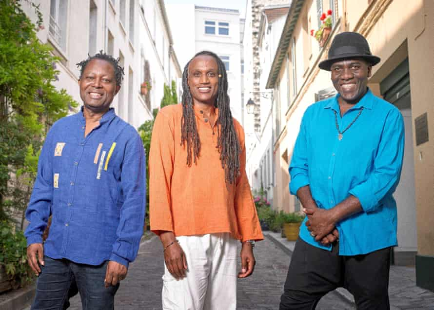 lokua kanza gerald toto and richard bona posing in the street for a photograph