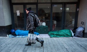 Homeless people sleeping in shopfronts in Birmingham city centre