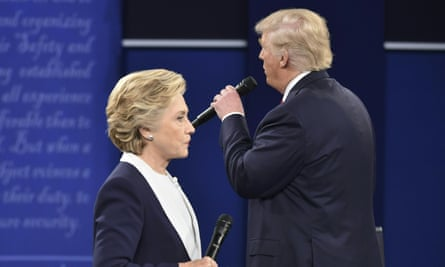 Donald Trump speaks as Hillary Clinton listens during the second presidential debate. Her lead in the polls was at its biggest when she closed the debates with a 'mission' to 'grow an economy, to make it fairer, to make it work for everyone'.