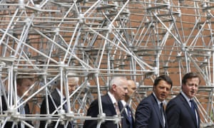 David Cameron, right, flanked at left by Italian Premier Matteo Renzi, visiting the British pavilion at the 2015 Expo in Rho, near Milan, today.
