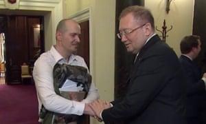 Charlie Rowley shakes hands with Alexander Yakovenko