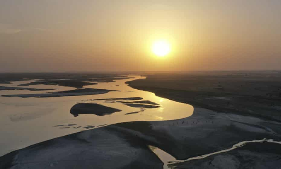 The sun sets over the Ganges