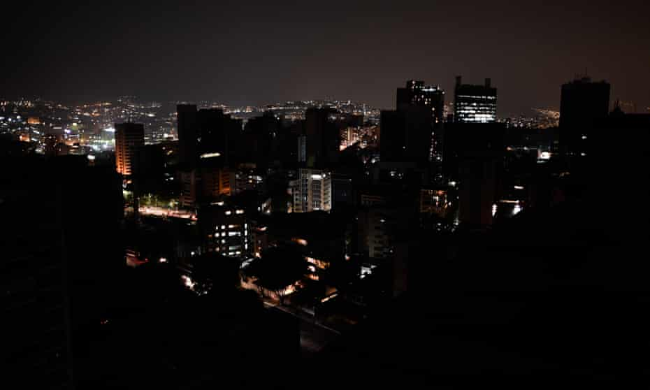 A general view of Altamira neighborhood partially illuminated during a power outage in Caracas, Venezuela on 26 March.