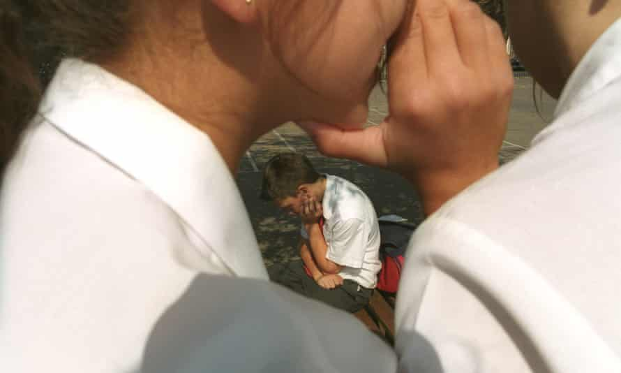 Schoolchildren whisper about a fellow pupil