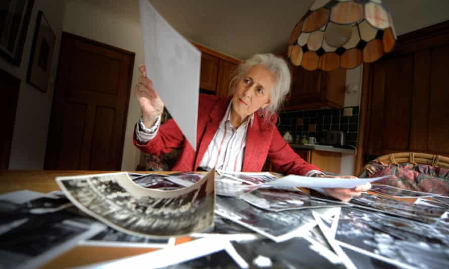 Grace Robertson sorting through her photographs in 2009.