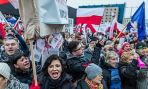 Protesters take to the streets of Warsaw to denounce Poland's new media law