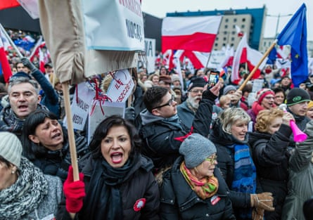 People attend a protest against a new media law in the centre of Warsaw on 9 January 2016
