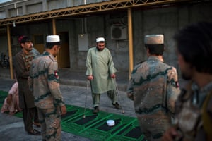 Dusk prayers at a border police base in Lashkar Gar, Helmand's provincial capital, commanded by Maj Ghulam Wali Afghan, who lost both legs to an IED six months ago.