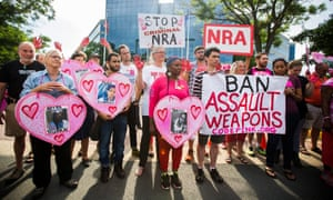Demonstrators with the activist group CodePink, along with other gun control advocates, hold a protest outside the headquarters of the NRA.