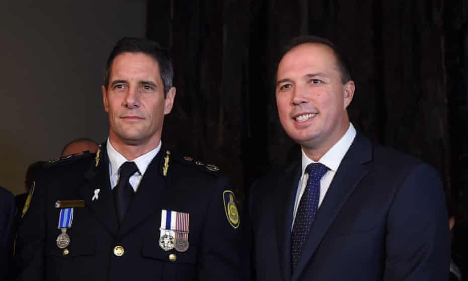 Peter Dutton congratulates the then commissioner of the Australian Border Force, Roman Quaedvlieg, during the swearing-in ceremony in 2015.