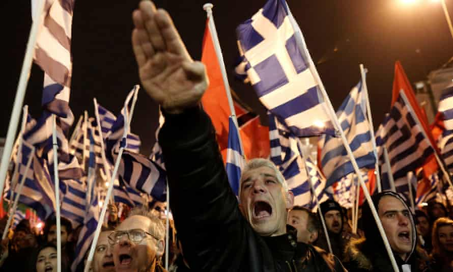 A supporter of Greece's far-right party Golden Dawn raises his hand in a Nazi-style salute during a rally in Athens in 2014.