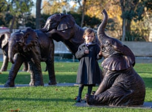 London, UK, School children unveil 21 bronze life-sized elephants at Marble Arch. The sculptures, by artists Gillie and Marc, have been created to highlight the plight of the species which could face extinction by 2040