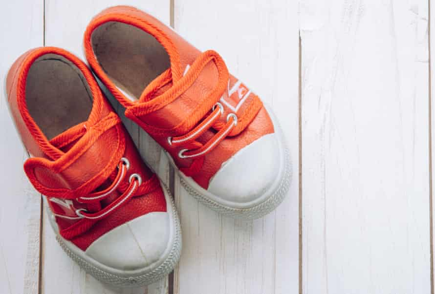 Red shoes for children on wooden floor