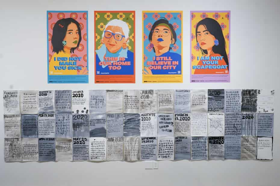 Posters created by the City of New York to combat Asian hate are on display at the Museum of Chinese in America.