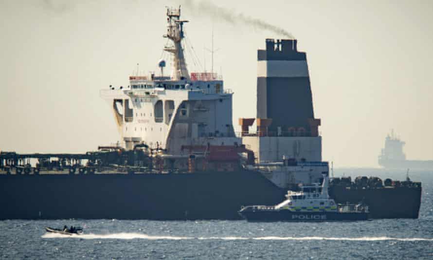 Royal Marine patrol vessel is seen beside Grace 1 super tanker off Gibraltar.