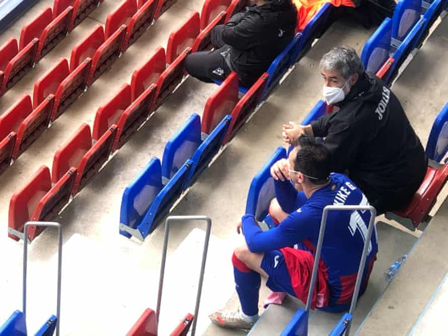 Eibar's Kike García sits in the stands to watch the final few minutes of his team's win over Alaves with goalkeeper coach Josu Anuzita