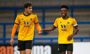 Max Kilman (left) congratulates Niall Ennis after his goal for Wolves reserves against West Brom at New Bucks Head Stadium Telford.
