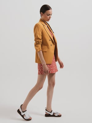 model wears skirt, £26, and top, £25, both by Narrated, from urbanoutfitters.com. Blazer, £49, topshop.com. Sandals, £90, drmartens.com.
