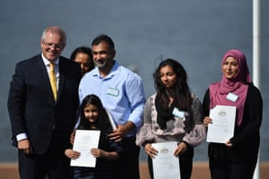 Prime minister Scott Morrison hands out citizenship certificates to Rao Asim from Pakistan, daughters Kashmala and Fajar and wife Hina during an Australia Day citizenship ceremony in Canberra.