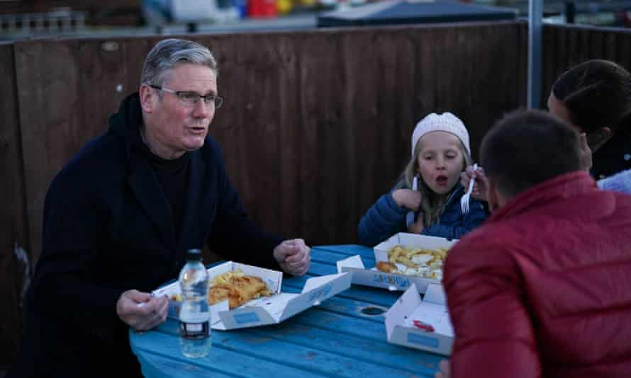 Keir Starmer eating fish and chips with a family in Hartlepool