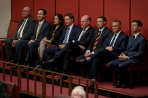 Colleagues from the other place gather to watch Senator George Brandis
