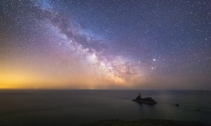 Milky Way streaks across the sky at Broad Haven in Pembrokeshire with the iconic Church Rock out to sea.