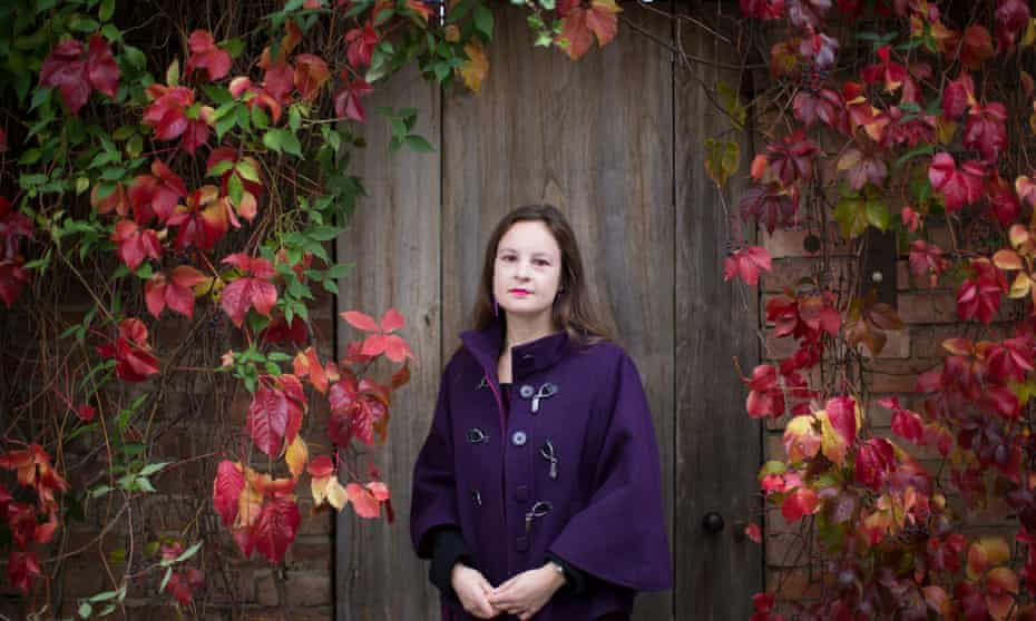 New president of the Universities and Colleges Union, Vicky Blake, in purple coat standing against autumn leaves