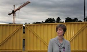 Amanda Manuel outside building site, crane in background