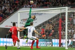 Hogg tips Rooney's effort over the bar.