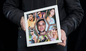 Jodie Reynolds holds photos of her son, Nathan