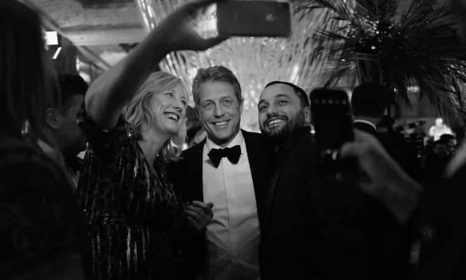 Carole Cadwalladr takes a Bafta selfie with Hugh Grant and Karim Amer, director of The Great Hack.