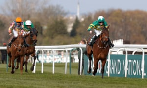 Rachael Blackmore on Minella Times (right) leads from Balko des Flos and Any Second Now to claim their historic victory in the Grand National.