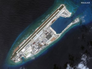 This March 2017 image provided by Maxar Technologies shows a satellite image of the Chinese-occupied Fiery Cross Reef in Spratly island chain in the South China Sea, one of several disputed islands, reefs or shoals in the area.
