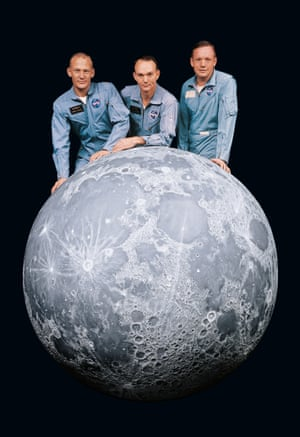 Buzz Aldrin, Michael Collins and Neil Armstrong pose behind a 6ft model of the moon three months before their Apollo 11 mission