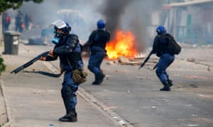 Heavily armed police fire rubber bullets and use tear gas to clear protests