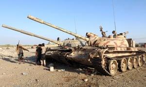 Yemeni pro-government soldiers stand next to tanks near the port city of Hodeidah, Yemen.